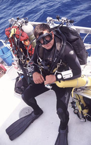 A technical diver suited up and ready to dive.