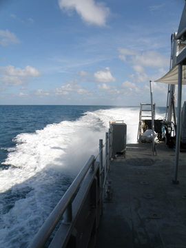 Looking down the starboard side of R/V MANTA toward the stern to see the wake behind the boat underway.