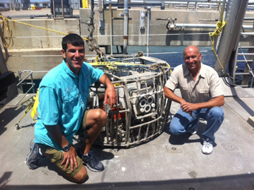 R/V MANTA Captains Mike and Darrell posing with a recovered camera array on the deck of the boat