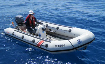 Ryan driving a rigid hull inflatable boat