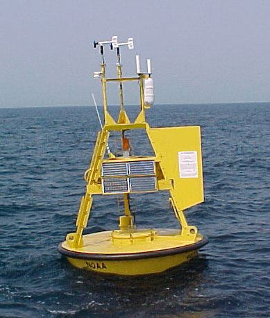 A bright yellow data buoy floating on the ocean