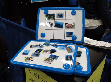 Small magnetic white boards with images of reef scenes and things impacting reefs to use as part of a tic-tac-toe game