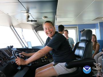 Teacher at the helm of R/V MANTA pretending to drive the boat