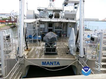 Stern of R/V MANTA with the ROV on deck under a tarp
