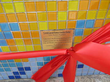 "The dedication plaque at the front of the bench says, ""Coral Corral - Flower Garden Banks"". Artist: Patricia Hagstrom. In Honor of: Galveston's Performing and Visual Arts Organizations and the Individual Artists who add Beauty and Energy to our Island. Special Thanks: Gavleston Commision for the Arts, Galveston County, Artist Boat"