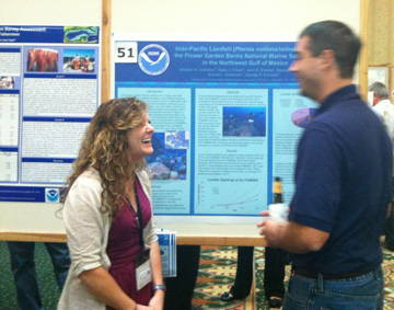 Michelle presenting a lionfish poster
