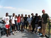 Group posing on an upper deck of Battleship Texas with the ship channel behind them.
