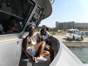Students sitting in front of the pilot house of the R/V Manta.