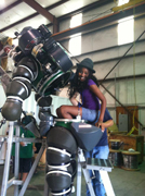 Chanel climbing into a large diving suit used for deep dives.