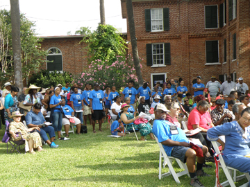 Crowd of people at the Ashton Villa Juneteenth celebration on the lawn.