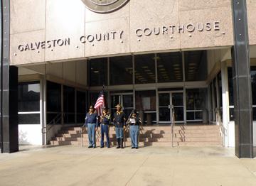 Buffalo soldier re-enactors standing in front of the Galveston County Courthouse steps.