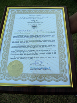 A framed proclamation from the City of Galveston.