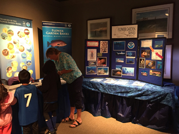 The sanctuary display inside Sea Center Texas with an extra table where kids are working on a craft with the help of a volunteer.