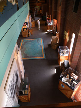 Looking down on a museum exhibit area from the second floor.