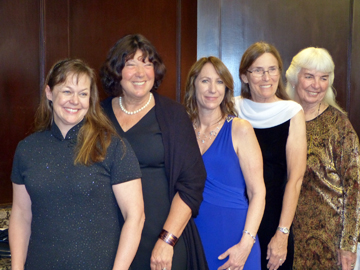 Five women standing in a row. This is the WDHoF Class of 2014.