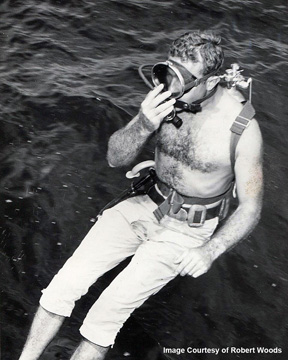 Diver entering the water for first science dive at the Flower Garden Banks in 1960