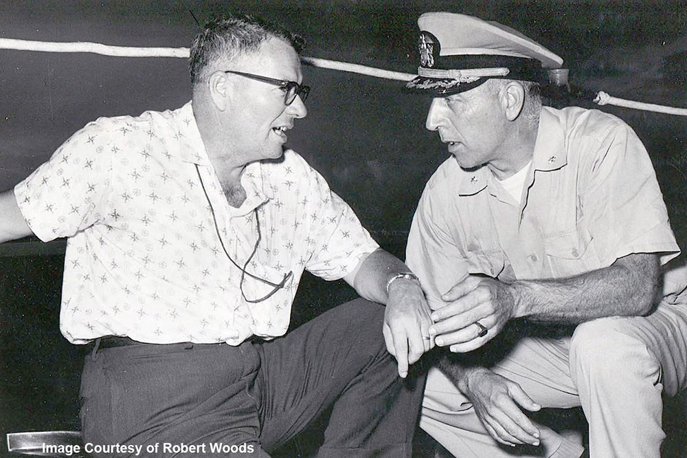 Tom Pulley talking to the captain of a Navy ship