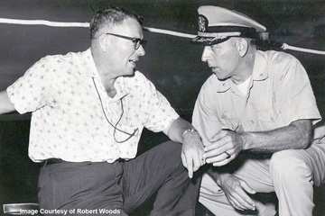 Tom Pulley talking to a Navy officer