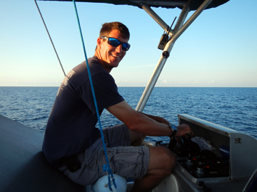Captain at aft controls on top deck of R/V MANTA