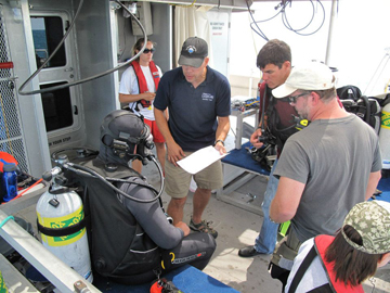 Divers gathered together for a briefing before the dive.