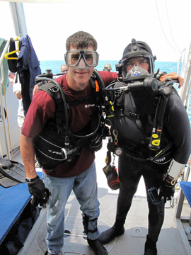 Two divers geared up and ready to go.