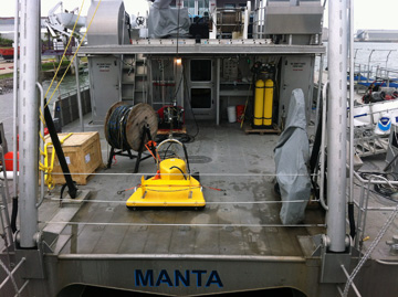 Bright yellow piece of equipment sitting on deck of R/V MANTA