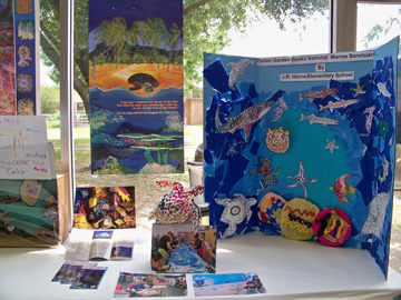 Display of aboriginal art created by school students to illustrate Flower Garden Banks National Marine Sanctuary