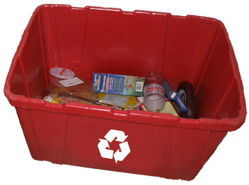 Rectangular recycling bin full of plastics and other items ready to be recycled.