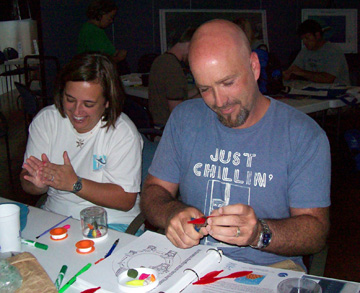 Two teachers making coral spawning globes in a workshop