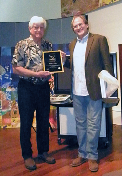 Tom receiving his volunteer of the year plaque from G.P. Schmahl