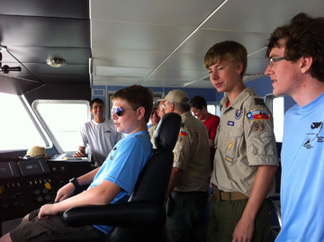 Boy scouts checking out the captain's seat on R/V MANTA