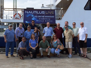 Group photo of council and staff members in front of E/V NAUTILUS at the dock in Galveston