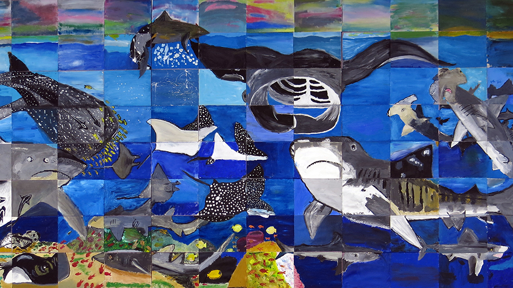 Mosaic mural of sharks and rays painted by Ocean Discovery Day 2017 visitors