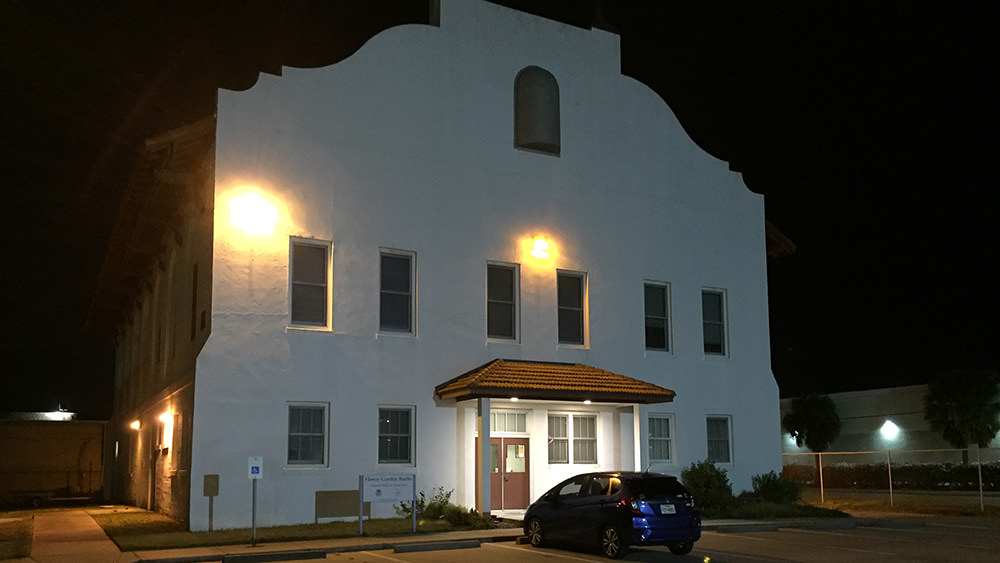 Night view of mission-style building that houses sanctuary offices